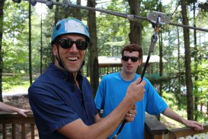 Zip across our lake on our 500 ft zip line!